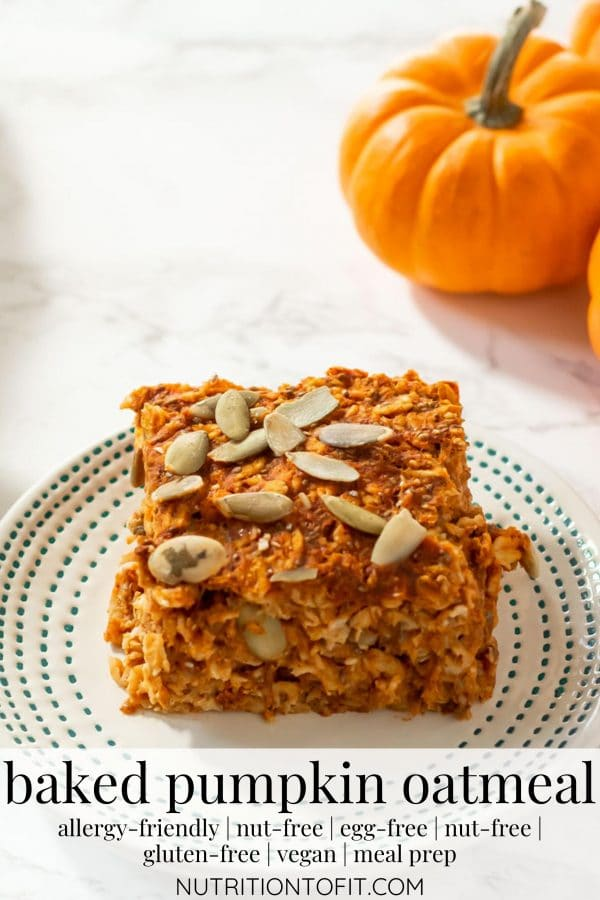 """Pinterest image of A square of baked pumpkin oatmeal topped with pepitas on a small ivory plate with tiny teal dots on the border with text """"baked pumpkin oatmeal"""""""
