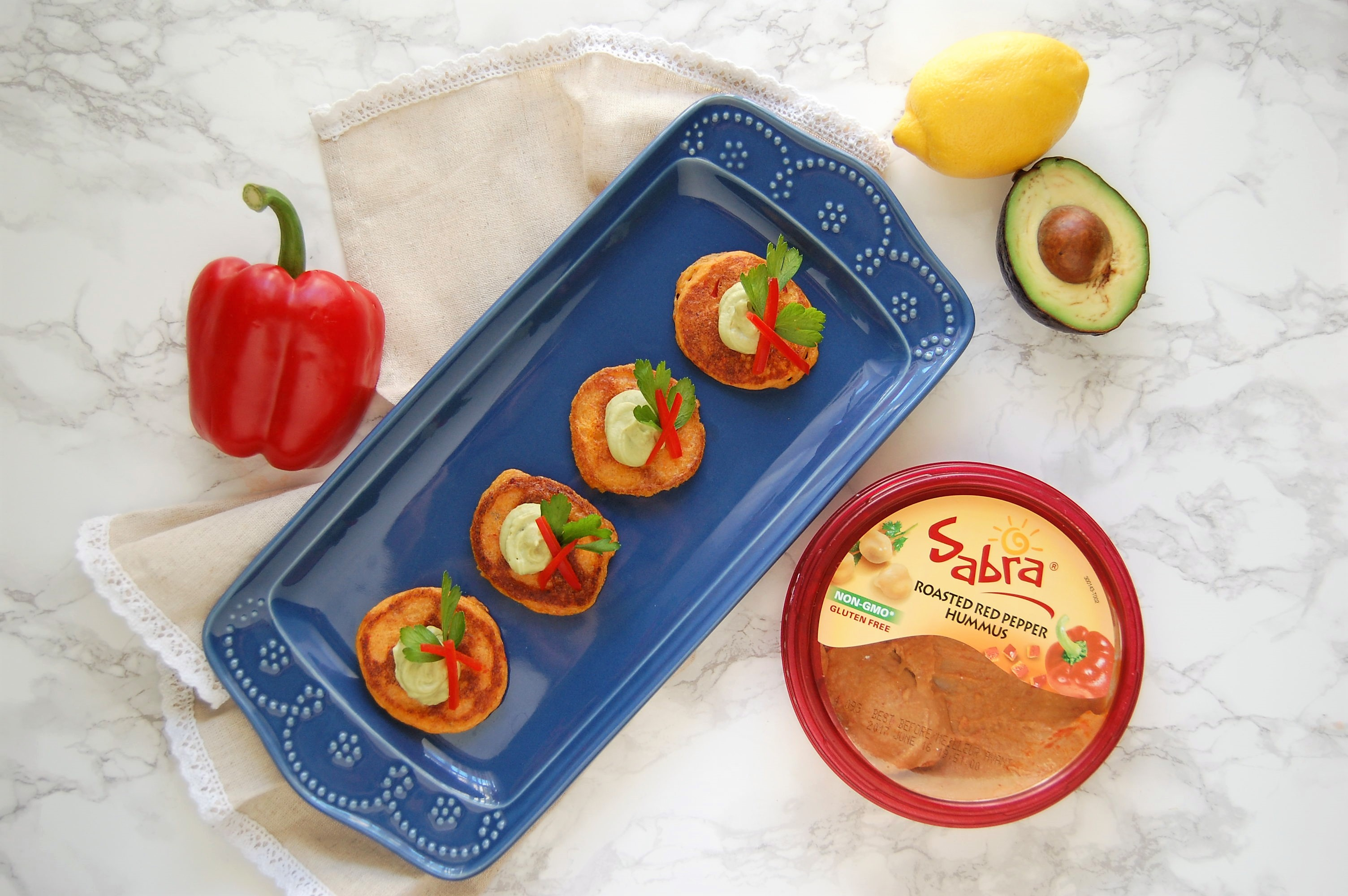 #ad May 13th is National Hummus Day, so why not throw a party with these Gluten Free Hummus Poppers with Whipped Avocado Hummus? They are crisp, light, airy, and full of so much flavor. Best yet? They're awesomely customizable to your favorite Sabra hummus!