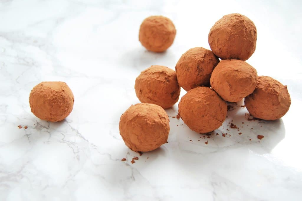 Make these simple, bite-sized, four-ingredient Chocolate Avocado Truffles for your next dinner party or special occasion! They require very minimal hands-on time and can be made ahead. Check the post at nutritiontofit.com for other ways to get creative with these chocolate avocado truffles, too! @nutritiontofit