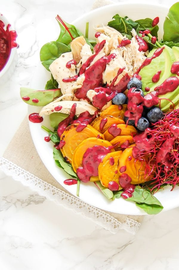 This golden beet salad with blueberry lime dressing is a colorful, healthy salad recipe that is packed with nutrition and flavor!