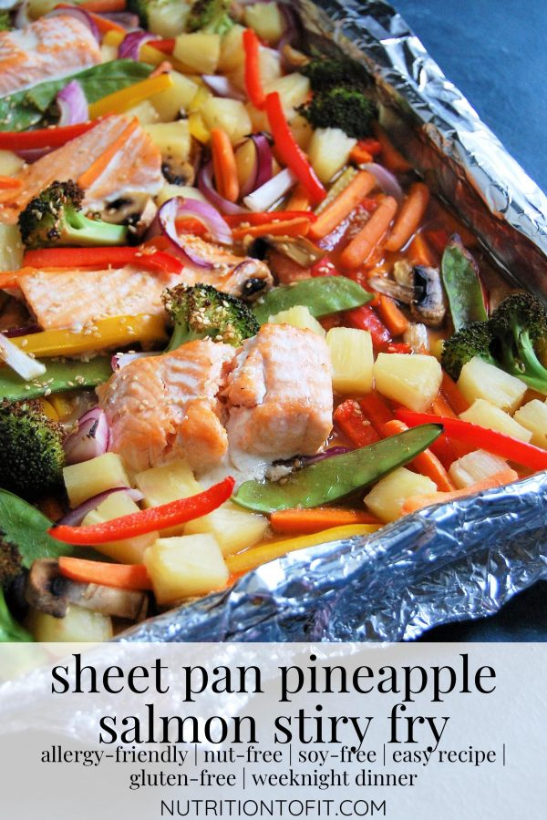 Pinterest Image of sheet pan pineapple salmon stir fry pulled fresh from the oven.