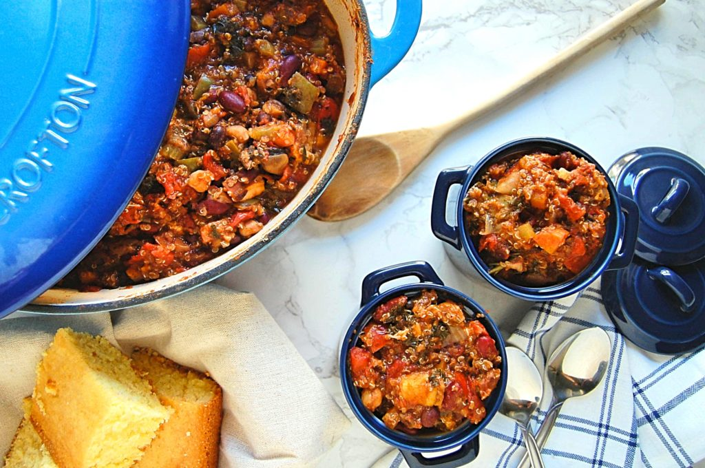 Hearty Vegetable Chili in individual blue cups with cornbread