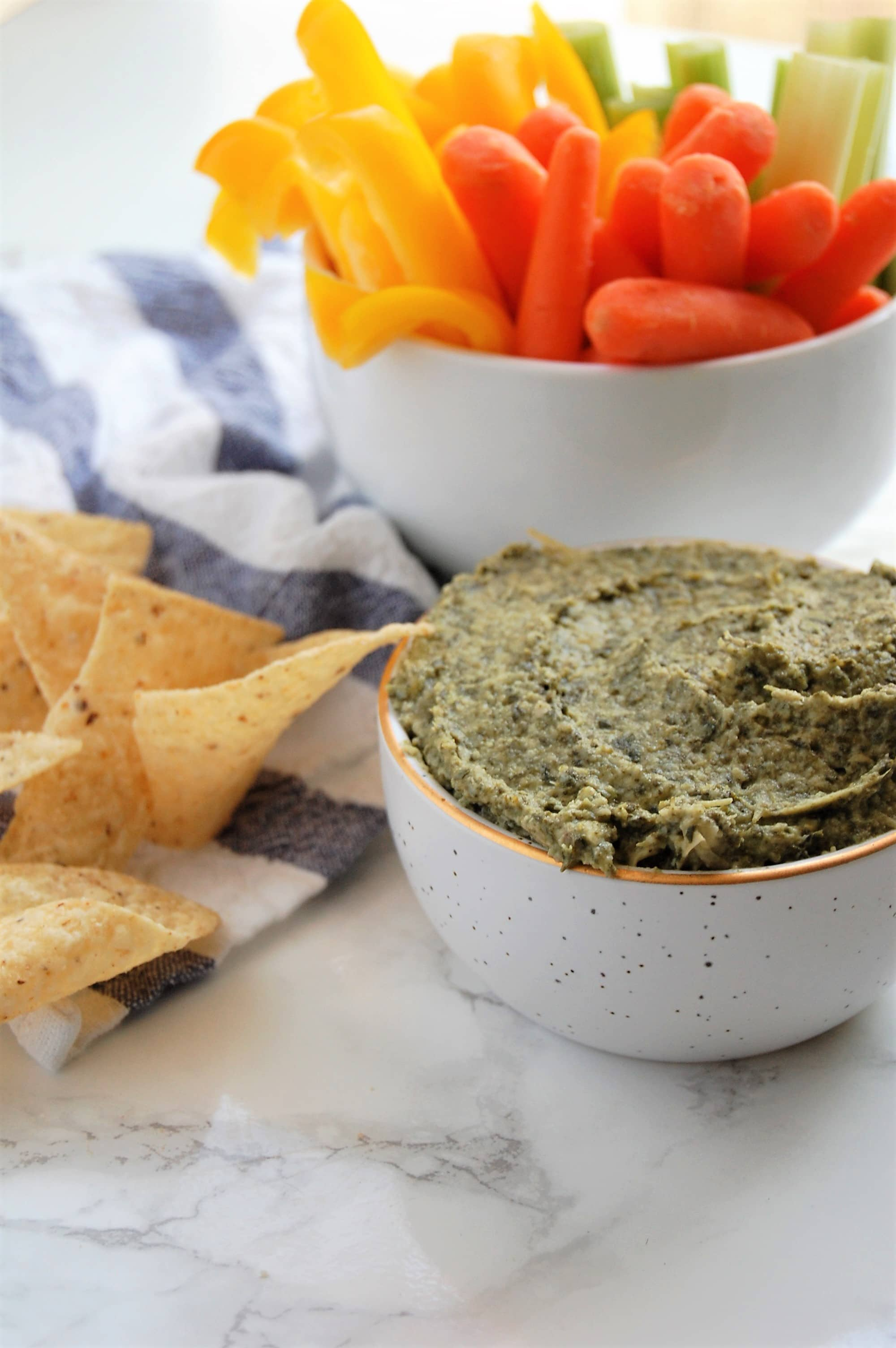 This Spinach Artichoke Dip is super easy and fast to make with just three ingredients. Bonus? It's vegan and a great option for food allergies and sensitivities!