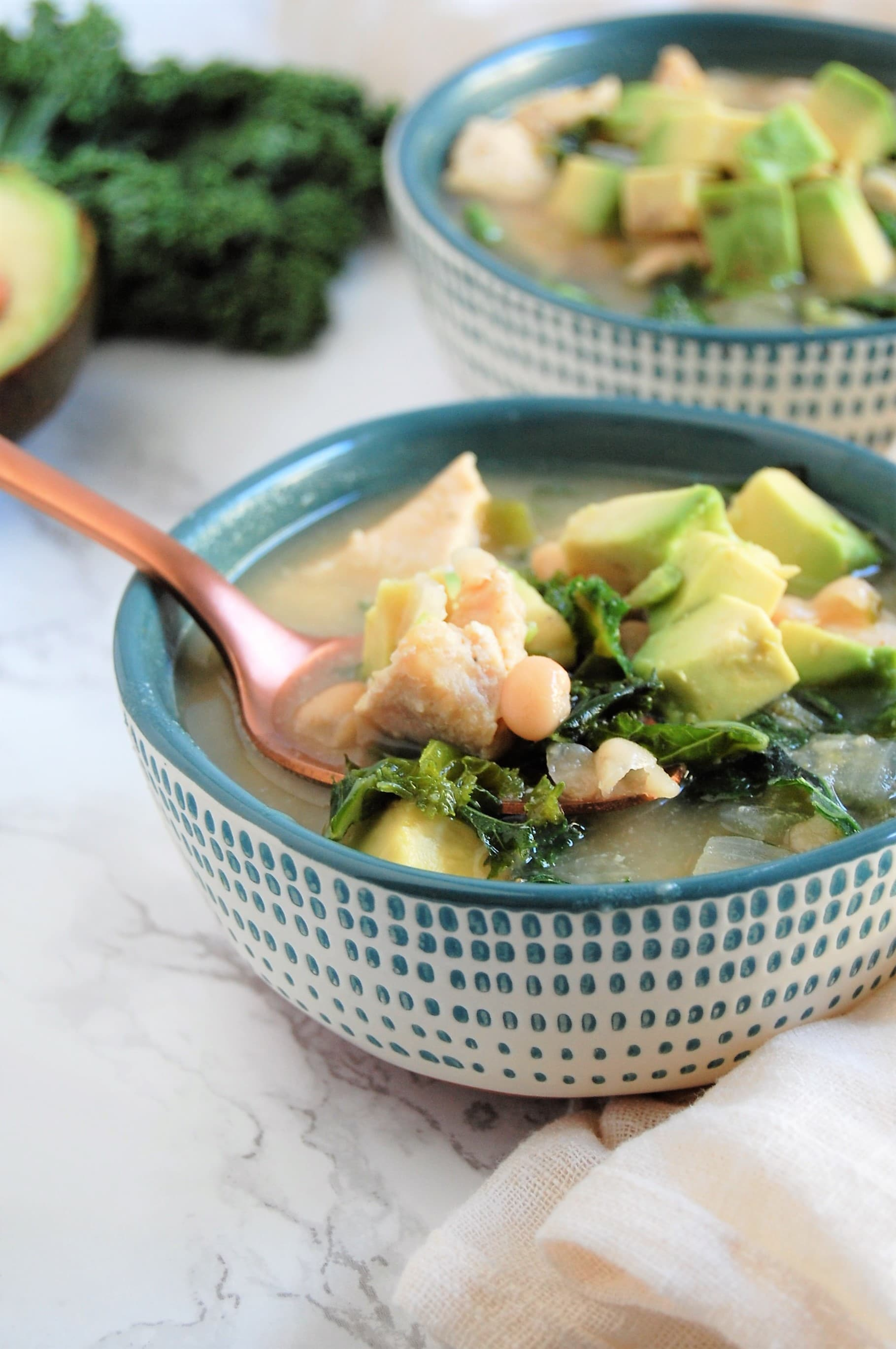 This Chicken & Kale White Bean Chili is packed with delicious flavor, family-friendly, and naturally gluten- and dairy-free.