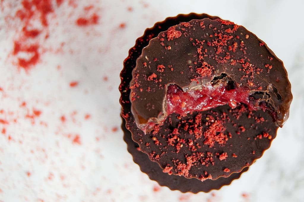 These Raspberry Caramel Chocolate Cups make a simple dessert that have just four ingredients! With a fruit-based center, the only added sugar is in whatever type of chocolate you choose! Gluten-free, nut-free, optional vegan, dairy-free.