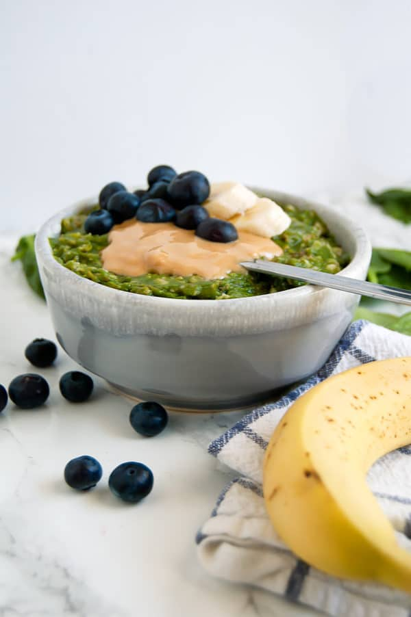 Green Smoothie Oatmeal is the perfect hybrid breakfast when you want both an energizing green smoothie and a cozy warm bowl of oats. This green oatmeal is gluten-free, dairy-free, egg-free, nut-free, and vegan.   Nutrition to Fit