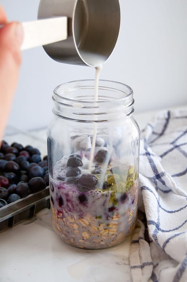 These Blueberry Matcha Overnight Oats are everything that you need in the morning: nourishing, filling, delicious, have a little caffeine, and require less than five minutes of prep time the night before! | no added sugar, gluten-free, dairy-free, vegan, nut-free | Nutrition to Fit