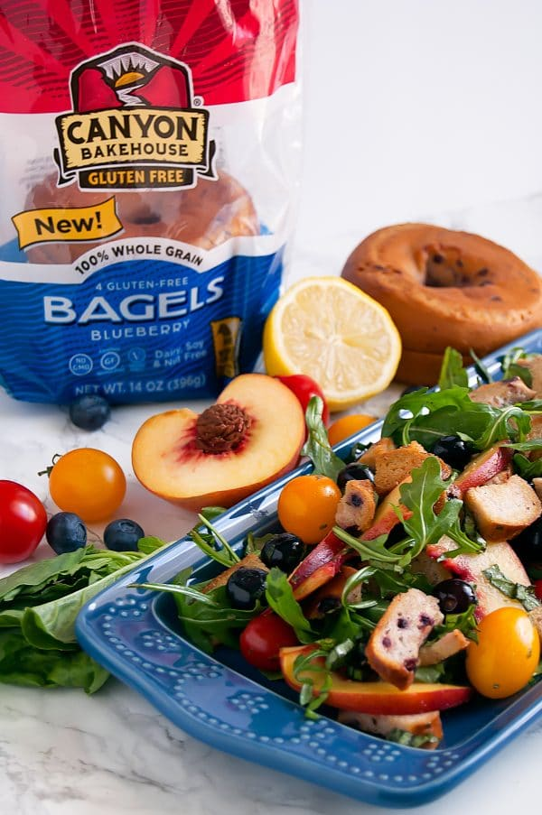 Blueberry Panzanella on a long blue plate with Canyon Bakehouse Gluten Free Blueberry Bagels