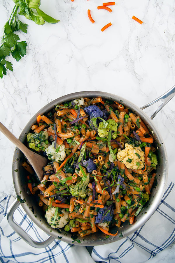 This One-Pot Lentil Pasta Primavera is a gluten-free, vegan, flavorful, springtime pasta dish that's so easy you don't even need to boil the pasta separately! | #easyrecipe #vegan #plantbased #vegetarian #onepotpasta #glutenfree #dairyfree #pastaprimavera | Nutrition to Fit