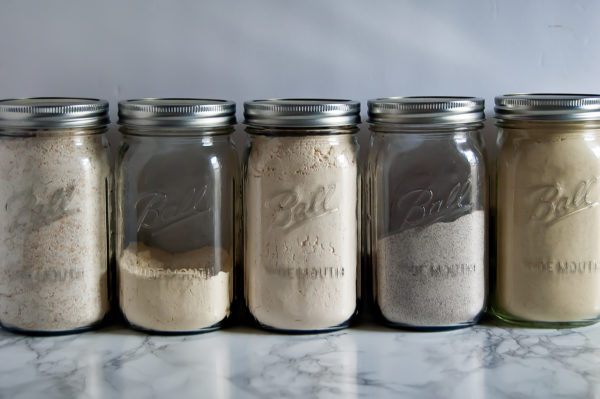 Storing gluten-free flours in large mason jars is an easy, clean way to spring clean your kitchen.