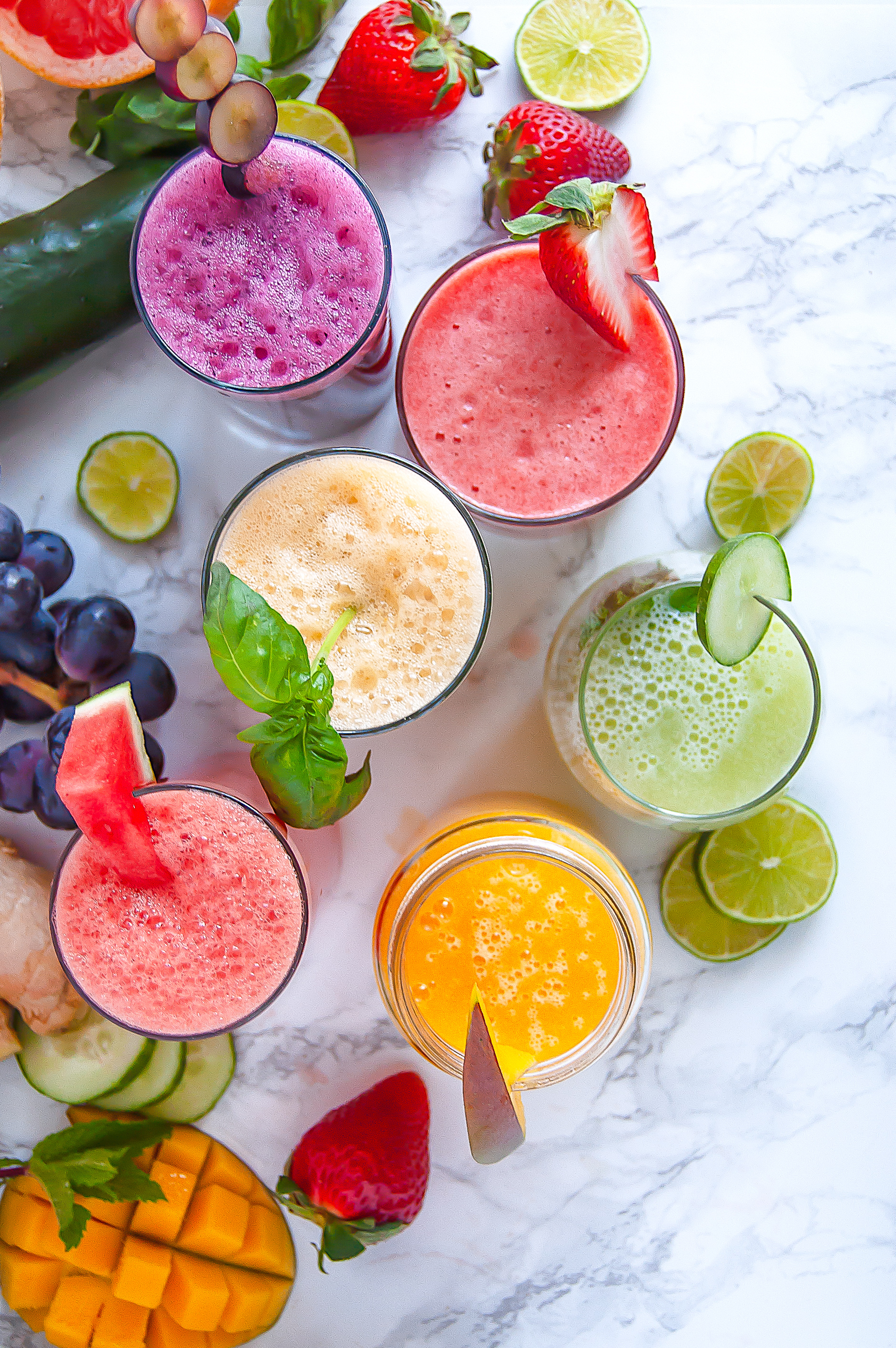 overhead shots of various brightly colored agua frescas