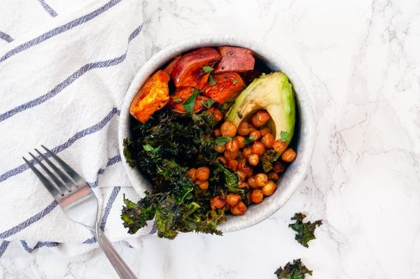 sweet potato bowl with avocado, crunchy chick peas, and kale chips