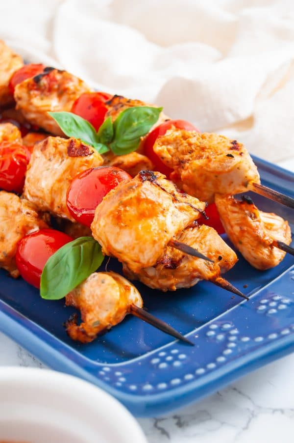 Tomato basil chicken kabobs make an easy, healthy chicken kabob recipe with a simple, flavorful tomato basil marinade. These tomato basil chicken kabobs are perfect for fresh summer grilling!