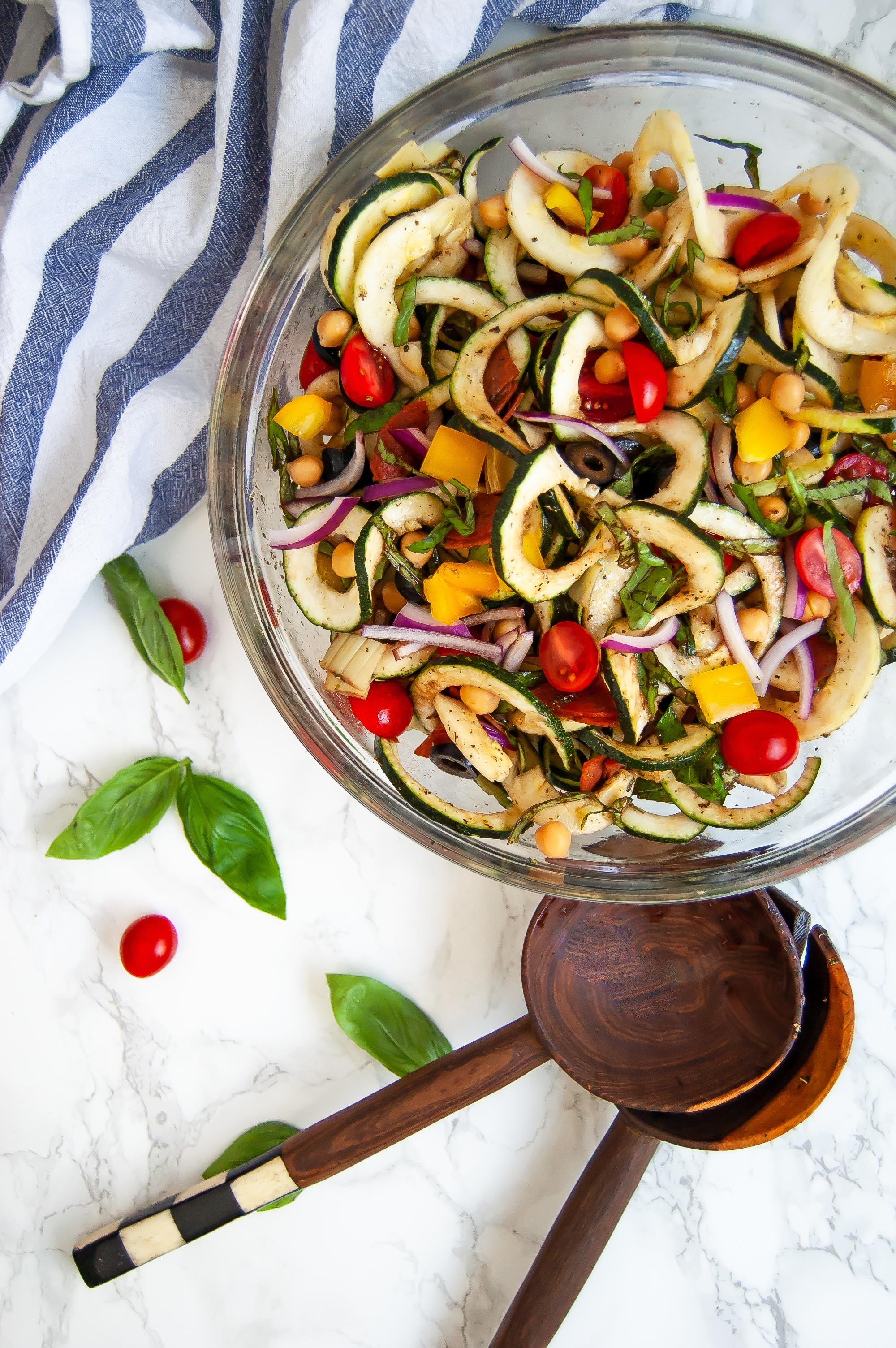 Antipasto salad gets a light and fresh take with this zucchini noodle antipasto salad. A fun zucchini noodle pasta salad, it's perfect with any healthy summer meal.