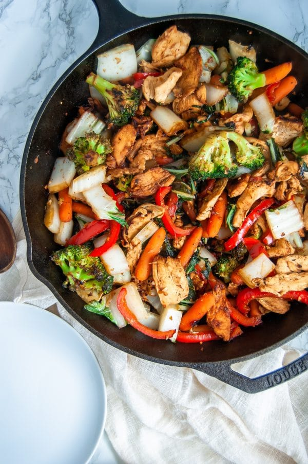 Easy chicken stir fry with garlic ginger sauce is a simple, healthy meal that can be made on a busy weeknight or easily added to your meal prep rotation.