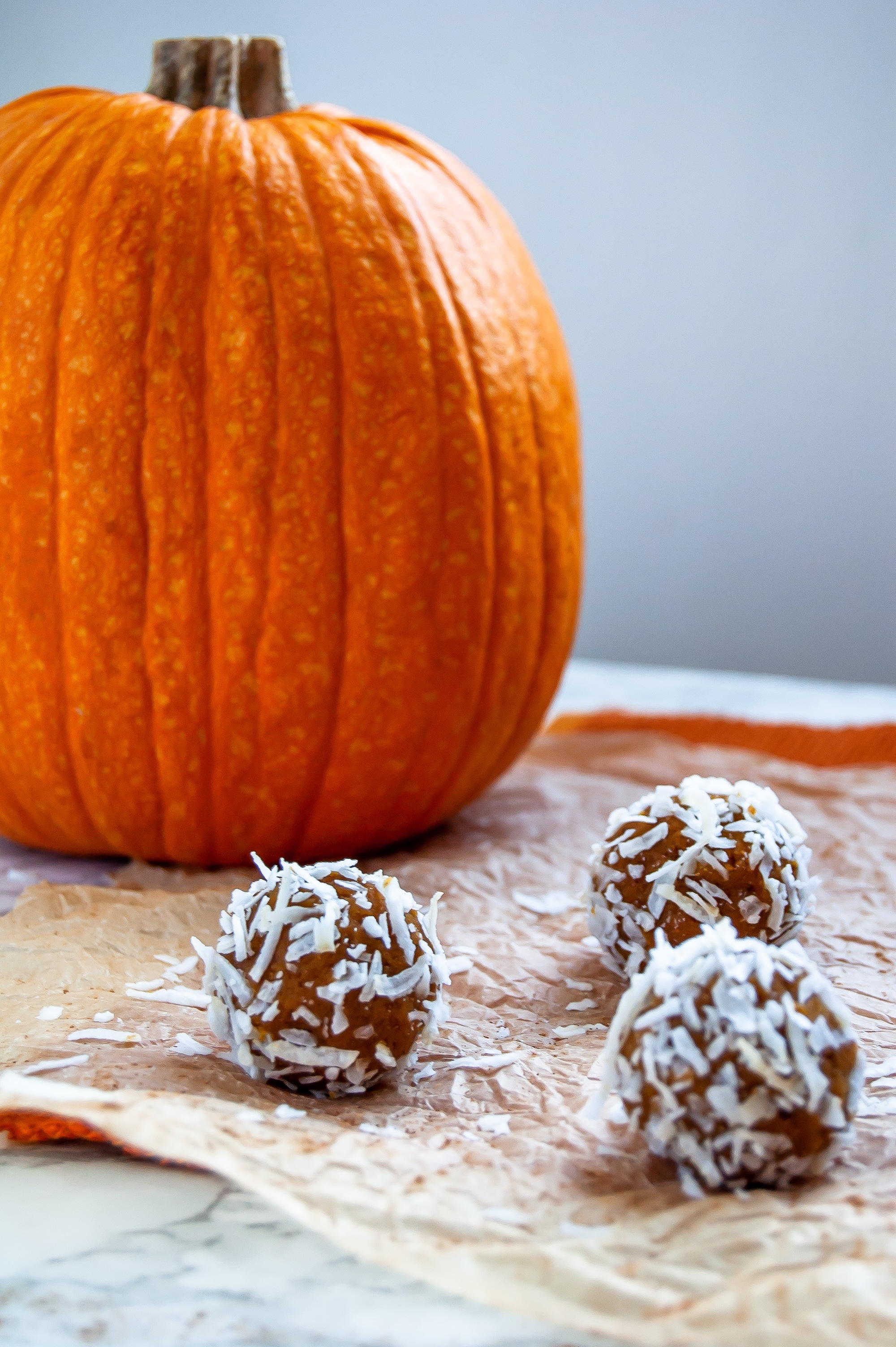 Collagen pumpkin protein balls are the perfect fall high protein snack! They're lightly sweetened with medjool dates and are full of  high fiber foods, too!