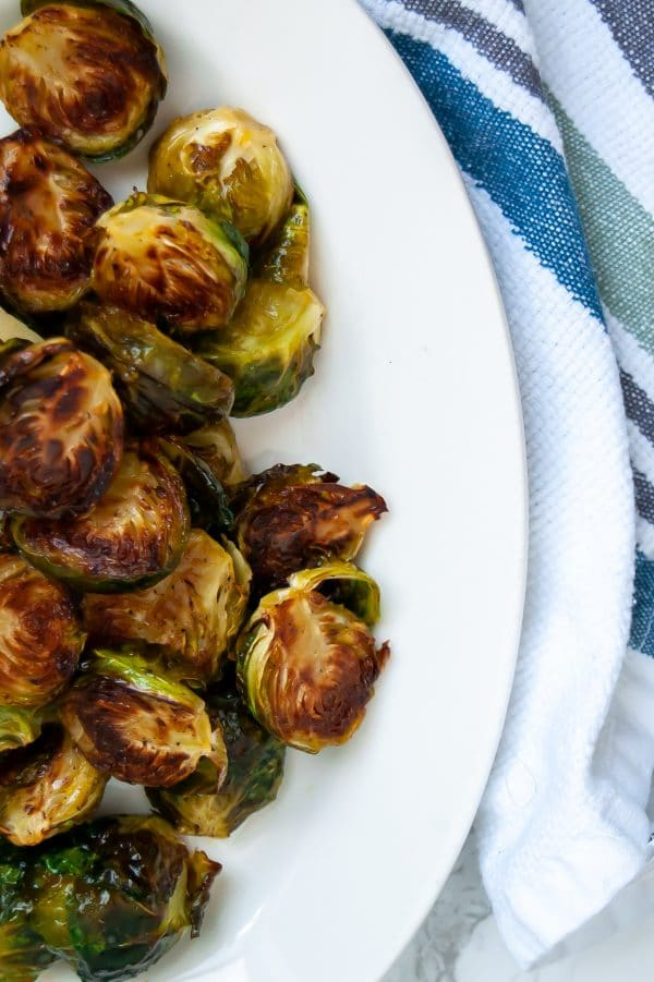 Maple dijon brussels sprouts are your answer to add flavor to easy roasted brussels sprouts. Try this easy, healthy side dish recipe today!