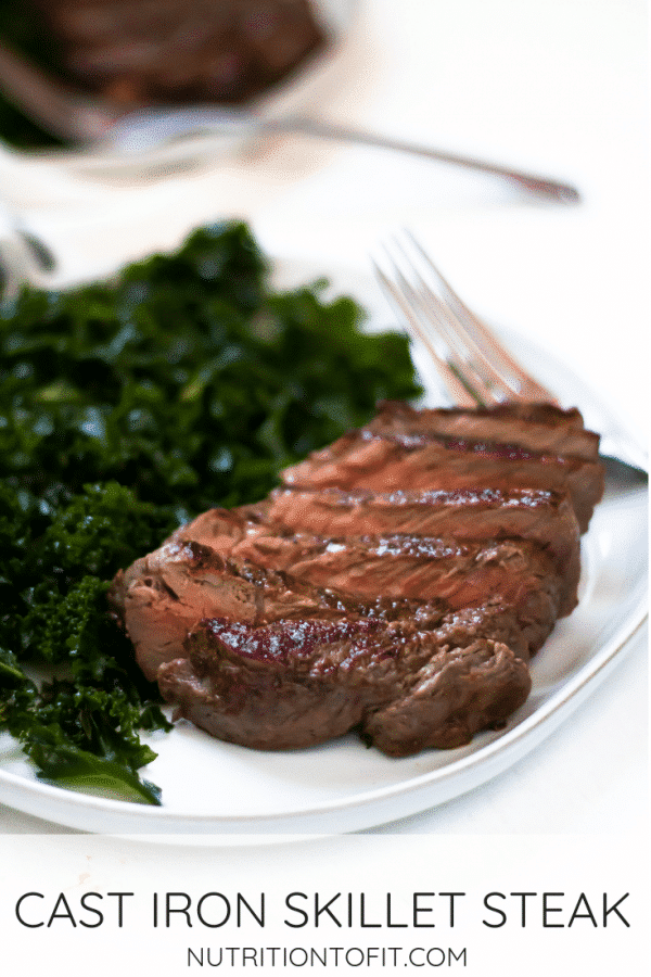Pinterest Image of sliced cast iron steak on a white plate with massaged kale salad.