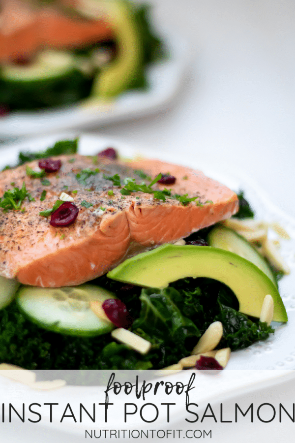Salmon over a massaged kale salad with text at the bottom that reads foolproof instant pot salmon.