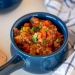 Blue crock of beanless chili with beef and vegetables