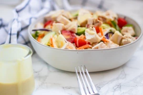A grilled chicken honey mustard salad.