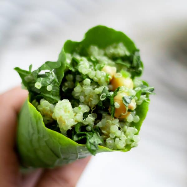 chickpea quinoa salad wrapped in a large turnip green leaf