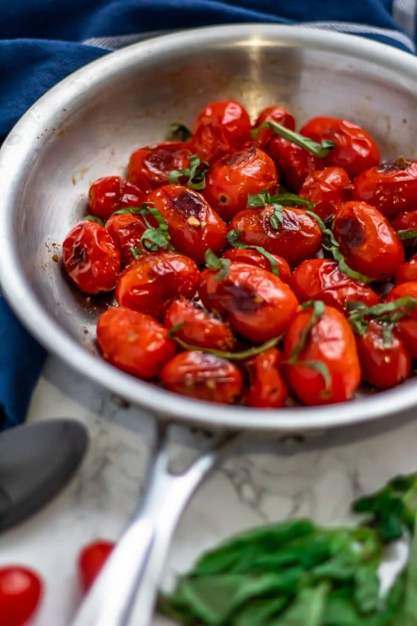 Blistered Tomatoes in a silver skillet