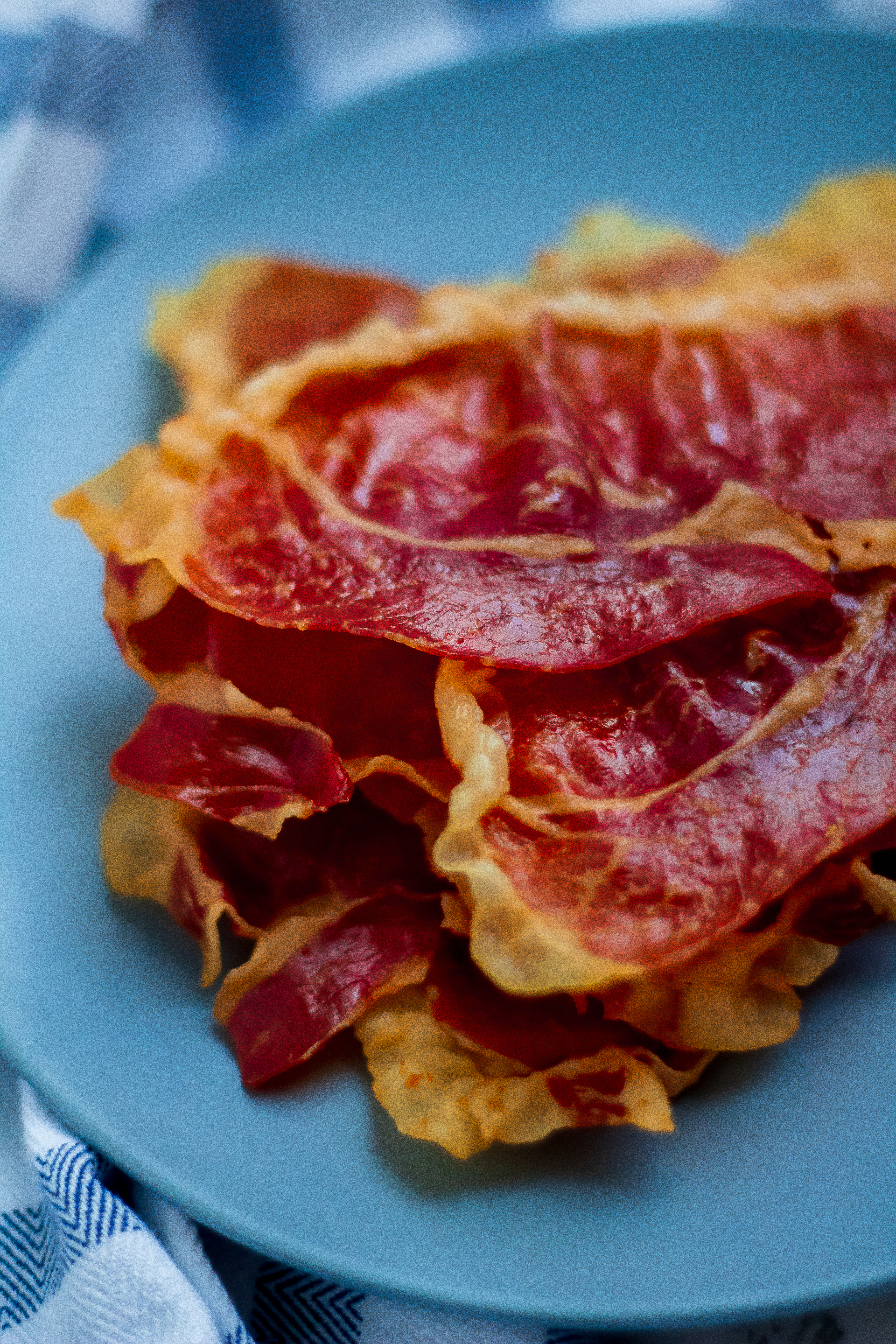 Crispy Prosciutto on a blue plate