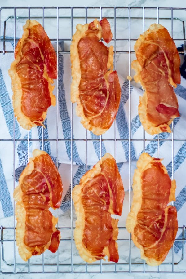 Crispy Prosciutto on baking rack with blue and white towel