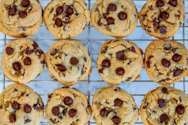 golden brown chocolate chip cookies on a silver wire cooling rack