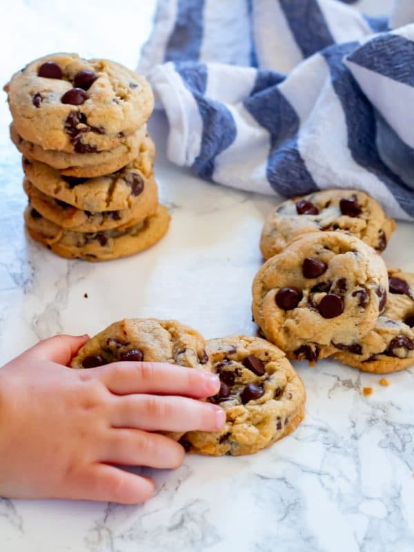 a toddler hand stealing a cookie