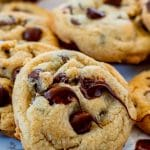 a close up of melty chocolate chips on a gluten free chocolate chip cookie