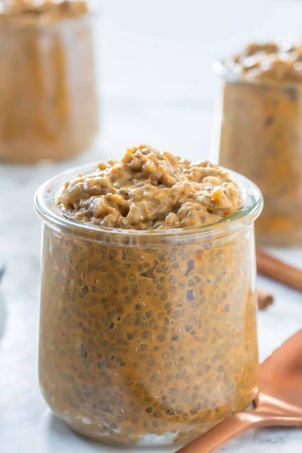 pumpkin chia pudding heaped into a small glass jar