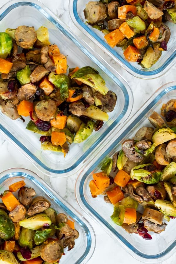 autumn chicken sausage sheet pan dinner in meal prep glass containers.