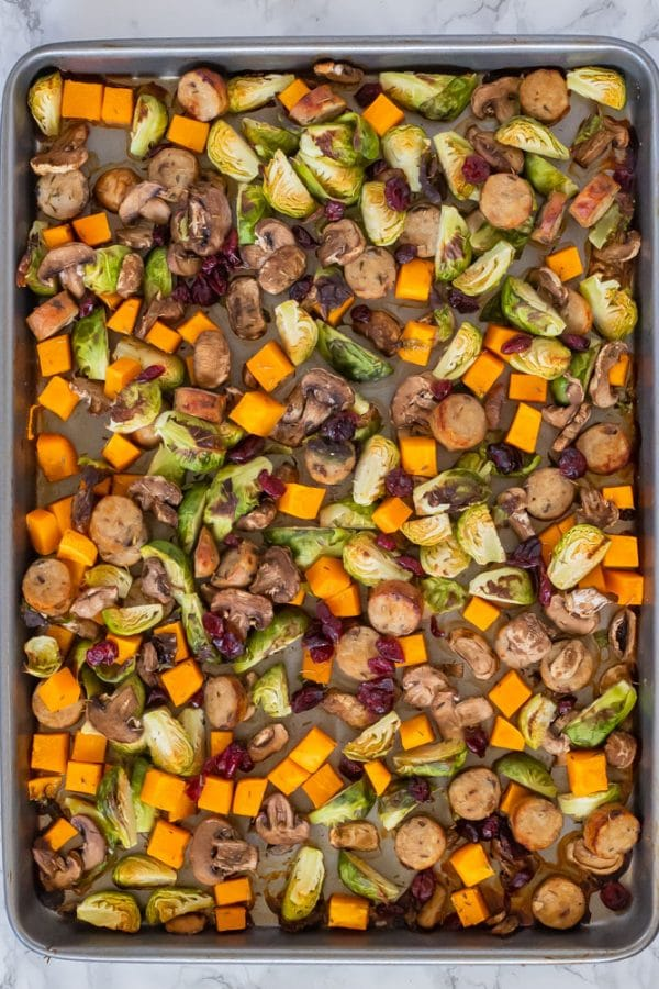 autumn chicken sausage sheet pan dinner on a sheet pan