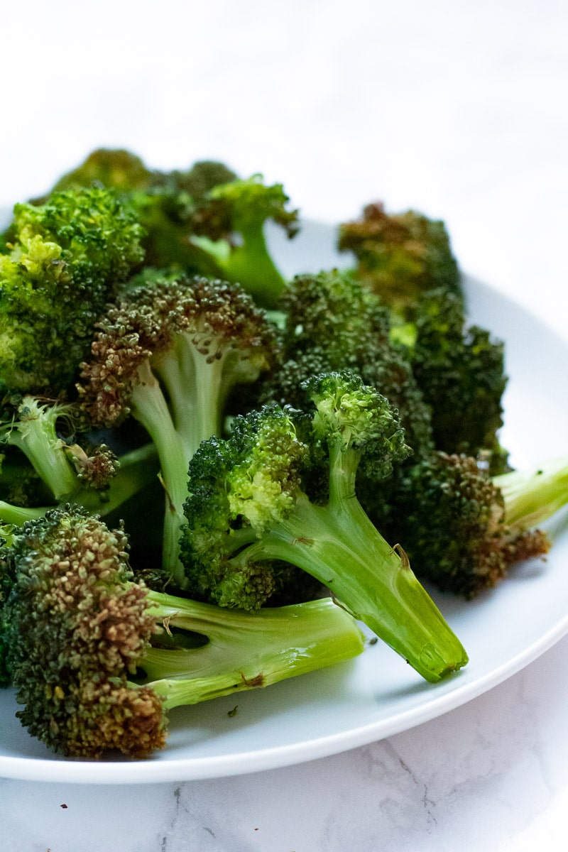 crispy broccoli florets on a white plate