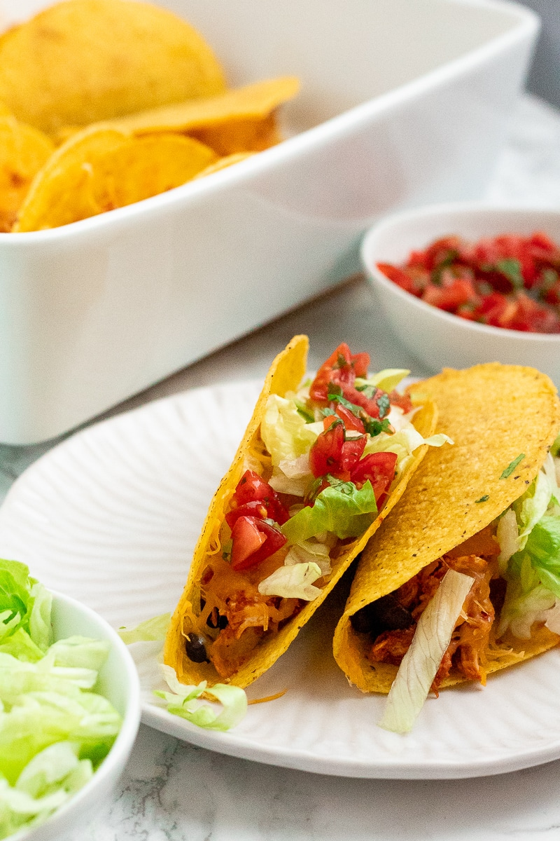 two crunchy tacos on a plate