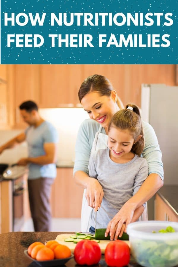 "a mom helping her daughter chop vegetables with dad cooking at the stove in the background. Text on top of image states ""how nutritionists feed their families"""