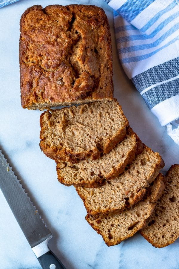 whole wheat beer bread sliced on marble